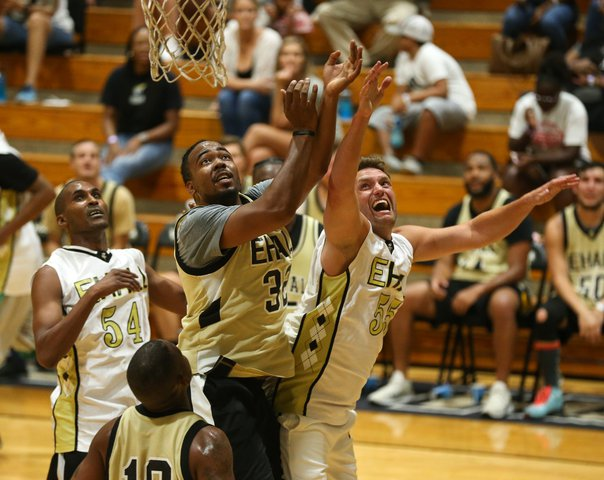 Alumni players fight for a rebound during a series of alumni games to help raise money for the boys and girls basketball programs at East Hall High School on Tuesday, July 16, 2019.